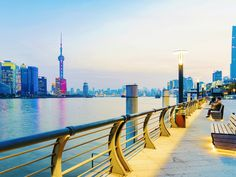 Walk the Bund in Shanghai and admire the city's towering skyscrapers.