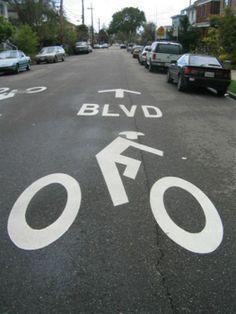 BICYCLE BOULEVARDS, Berkeley, with gigantic bike symbol. Wayfinding Signs, Signage, David Baker, Golden Gate Park, Bike Path, Traffic Light, Pavement, Tool Box, Budapest