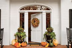 Elevated Autumn Urn - Best Ideas for Fall Container Gardening - Southernliving…