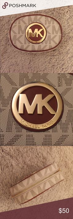 Michael Kors Cosmetic Bag Michael Kors Cosmetic Bag. It's mini but it still fits a good amount of stuff! Super cute and it's in perfect condition - only used a couple of times. 6 inches in width 4.5/5 inches in height. Michael Kors Bags Cosmetic Bags & Cases