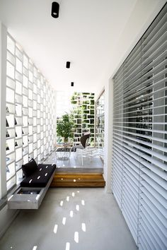 TLV Ben Gurion Weisel apartment, Tel Aviv-Yafo, 2015 - Dori Interior Design pinner: The  whole apartment is beautiful, but i like this outdoor area especially... privacy in a city setting, lets air and light in, two levels add interest and make the space seem larger. So beautiful and very functional.