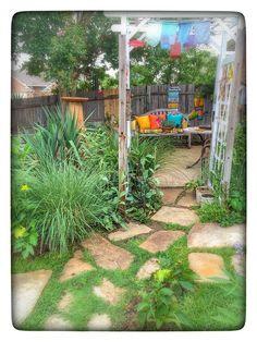 Garden Backyard Yard Fort Worth Texas Arbor Stone Walk Prayer Flags