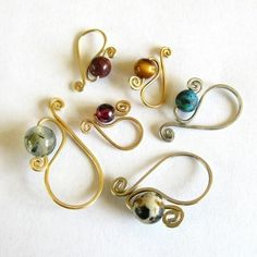 Removable stitch markers  http://www.etsy.com/listing/62148967/removable-stitch-markers-custom-mto?ref=sr_gallery_36&ga_search_submit=Search&ga_search_query=&ga_order=most_relevant&ga_ship_to=US&ga_view_type=gallery&ga_page=12&ga_search_type=favorites&ga_facet=favorites