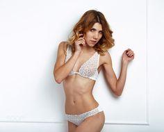 blonde girl in white lingerie by yuhymuk