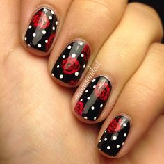 A playful choice for romantic women who want to do something girly. Black nail polish as base, red little roses with black lines and, if you want, little white dots for polka dot effect.