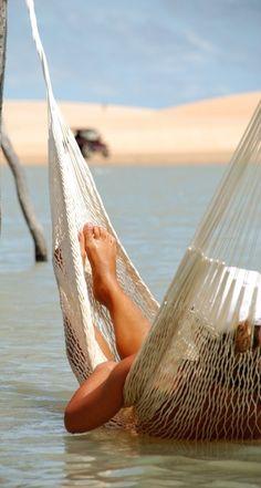 a hammock in the water.