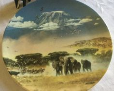 English Wedgewood 'The snows of Kilimanjaro plate' by Michael Johnson by VINTAGEwithaSMILE on Etsy Michael Johnson, Danbury Mint, Kilimanjaro, Natural Wonders, Elephant, English China, Snow, Plates, Nature