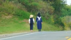 Amish boy and girl walking