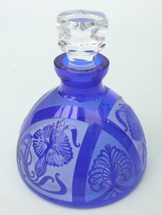 Mucha Style Scent Bottle   Vivid cobalt blue glass scent bottle in art Nouveau style with a Mucha pattern of a lady to the front. It was made in the 1980's in the Czech republic.