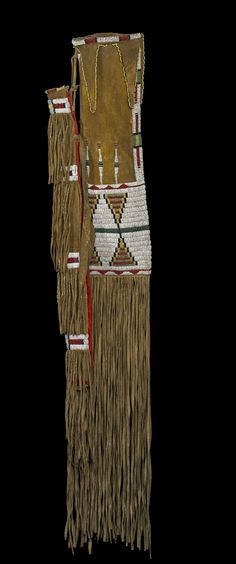 Bag, pipe-stem-case made of hide and decorated with beadwork.It is tied to another similar but larger pipe bag Am1935.