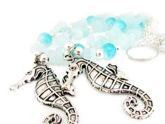 These seahorse curtain tiebacks are perfect to bring the beach into your home. The silver seahorse pendant is 2 inches long and hangs from a string of sea blue sea glass nugget bead. There are ocean blue crackle beads to add to the beautiful beach theme.. These are so perfect for your beach cottage chic decor. A beautiful way to decorate your beach house. These beach glass beads are made mostly of recycled glass material, hand-made into matte glass with sea glass finishing to mimic the…
