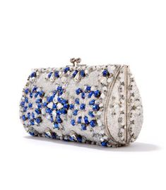 Metal clutch with imitation diamonds decoration, 1950's To make evening bags sparkle, imitation diamonds made from glass such as strass were often used. Strass is named after the German jeweller, G.H. #Strass, who invented the imitation diamond in 1730. In the 20's and 30's, strass became immensely popular mainly due to the costume jewellery designed by top designer Coco Chanel. Besides jewellery, strass was also used on hats, hat pins, shoes and business card holders.