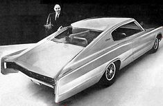 Elwood Engel with his prototype for the 1966 Dodge Charger