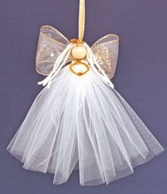 A pretty tulle angel using tulle ribbon for the body and wired edge ribbon for the wings: