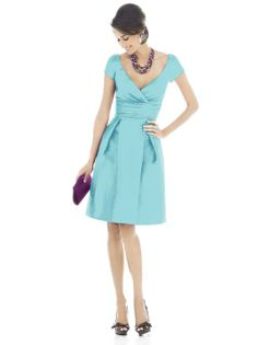 V-neck cap sleeve cocktail length dress in peau de soie has pleating at bodice and rouched inset midriff at natural waist. Pockets at side seams of skirt.  Sizes available 00-30W, and 00-30W extra length. Also available full length as style D503.  http://www.dessy.com/dresses/bridesmaid/d502/