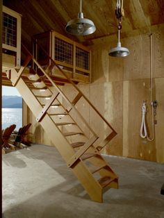 These last few examples depart from the standard straight run or switchback stairs. Here a loft is served by a staircase that is somewhere between a ladder and typical stairs. The steep pitch saves on floor space, important in compact plans where the upper floor is not used very frequently.