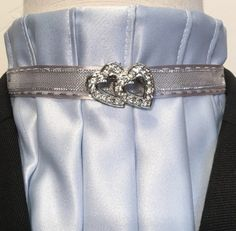 Topstitched upper pleats. Ultra low collar. Silver mesh ribbon layered on silver grey topstitched satin ribbon. Vintage pin- two heart clear rhinestone and silver sold separately.