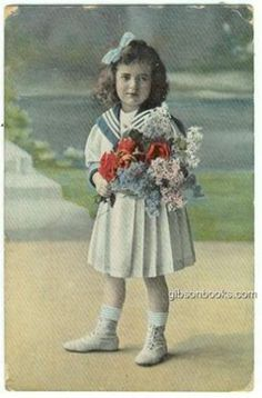 Postcard-of-Little-Girl-Dressed-Up-in-a-Sailor-Outfit-Holding-Flowers-1914