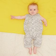 Buy this sleeveless playsuit with press stud front opening for babies. A perfect look to wear on its own when its hot, or team up with a T shirt in the spring.  In Doodle Grey, great gift for kids.