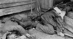 Two German machine gunners killed by explosive devices while attempting to enter a house somewhere on the Eastern Front. The man's head on the right has been completely destroyed.