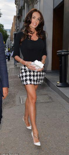 Tamara Ecclestone.. Wolford bodysuit, Balmain skirt, Christian Louboutin heels, and Chanel Lego clutch..