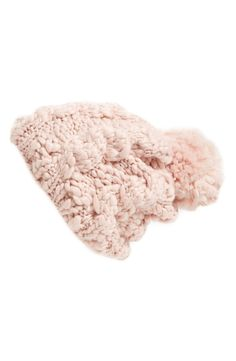A soft pom tops this superchunky knit beanie in pale pink.