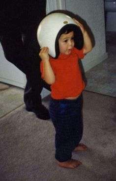 A young Kyle Larson trying on his first helmet