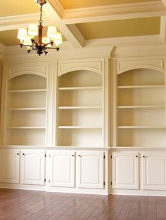《I really like how the cases on the end are slightly recessed from the rest, but the molding on top is a bit much. Raise bookshelf heights & use same molding & molding line as the rest of the room for a much nicer look》built-ins