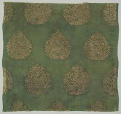 Swan Hunt, Jin dynasty (1115–1234). China. Plain-weave silk brocaded with metallic thread. Within each teardrop-shaped pattern on this textile is a hunting scene: a small fierce falcon at the top dives for a swan (or wild goose) amid flowers at the bottom. The spring hunt for swans was an annual event for the Mongols, and for the Jin and Liao dynasties before them. Similar imagery of falcons and swans appears on jade ornaments of the Jin and Yuan dynasties.