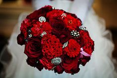 Nothing says romance like RED! Love this bridal bouquet by Laurel Designs