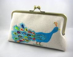 Oooh... I like this peacock clutch... maybe I could do a peacock theme for my birthday outfit too?
