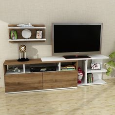 A well-crafted TV unit is an elegant piece of furniture on its own. The perfect example is our Beste White and Walnut TV Unit for only $382.53. Link in bio to get this!  Tags: #doseofmodern #furniture #furnituredesign #woodworking #interior #sofa #homedecor #decor #decoration #wood #woodwork #instadesign #table #interiors #homedesign #chair #livingroom #tv #television #tvshow #series #radio #drama #tvhost #actor #movies #cinema #actress #netflix #host Tv Unit Furniture Design, Tv Unit Design, Modern Tv Wall Units, Dcor Design, Adjustable Shelving, Storage Spaces, The Unit, Entertaining, Model
