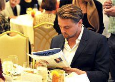 Suave Leo reading a magazine.