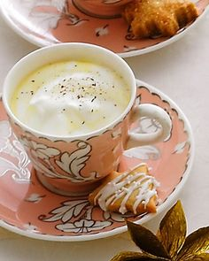 Classic Eggnog  Two quarts of milk, two cups of cream, and 16 egg yolks make a big batch of creamy eggnog for your holiday party. Bourbon and dark rum add a grown-up kick to this drink.