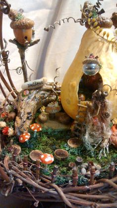 This lady makes amazing miniature fairy houses! Very talented! Click to see more. She has many different styles and items.