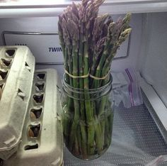 Keep asparagus fresher for longer by cutting the bottoms and putting them in a jar of water.