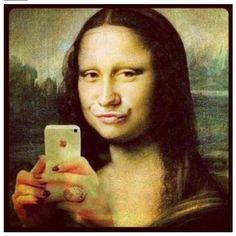 The Mona Lisa today - yes everyone takes pics in the mirror showing there phone and doing wierd lip movements