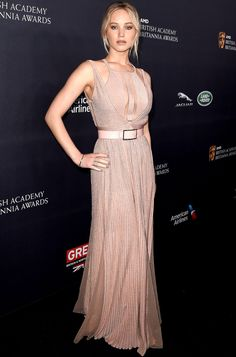 JENNIFER LAWRENCE' in an Elie Saab gown with cutout neckline and matching belt, plus EF Collection earrings and Le Vian rings and bracelet at the AMD British Academy Britannia Awards in Beverly Hills.
