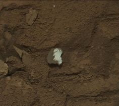 This raw image of a broken rock fragment in a rover wheel track, was taken by Curiosity's Mast Camera (Mastcam) on Jan. 17, 2013. When Curiosity drove over Tintina, the rock broke apart and exposed a fresh, bright white surface. The size of the rock is roughly 1.2 inches by 1.6 inches (3 centimeters by 4 centimeters).