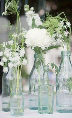 DIY Wedding Centerpiece..love the queen annes lace. I thought a wild flower bouquet would be awesome. elise you could even spray paint them a certain color