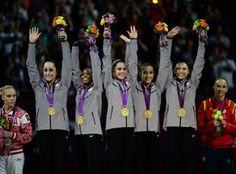 Jordyn Weiber, Gabrielle Douglas, McKayla Maroney, Alexandra Raisman and Kyla Ross celebrate with their gold medals after the women's gymnastics team competition Tuesday at the London 2012 Olympic Games.