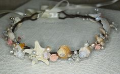 All my accessories is brand new as it has been handmade by mysel  ZhaNNa Design.      This elegant piece made with seashell,starfish,white and ivory freshwater pearls,glass pearls,biwa pearls and swarovski crystals. This headband is perfect for bride, bridesmaid, and flower girl.    Shipping:  Your item will be carefully packaged and shipped usually the next day after payment is received. Thanks for looking!    https://www.etsy.com/shop/ZhannaDesign?ref=si_shop