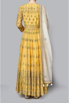 The yellow chanderi mull suit, is embroidered with floral motifs that remind you of lush beautiful gardens of summer. The Saranya kurta, paired with a churidar and dupatta, is the perfect addition to your summer wardrobe. Fabric: Chanderi Mull Content: 70% cotton/30% silk Production time: We require 6-7 weeks to dispatch this outfit.