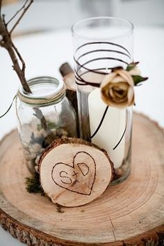 CENTERPIECE- I like the tree stump engraving and mason jars