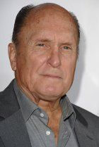 Robert Duvall. Veteran actor and director Robert Duvall was born on January 5, 1931, in San Diego, CA, the son of a career military officer who later became an admiral. Duvall majored in drama at Principia College (Elsah, IL), then served a two-year hitch in the army after graduating in 1953.