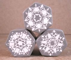 These unique snowflake canes resemble paper cut-out snowflakes. Very intricate designs can be made with this one, simple technique. The