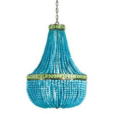 As beautiful as a piece of jewelry, the captivating turquoise and jade polished glass, create the classically shaped Hedy Chandelier by Currey and Company.  Hedy will add excitement and color to any of today's interiors.