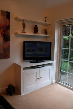 tv cupboard and curved floating shelves harrow