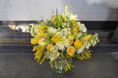 Our step-by-step slide show explains how to make three different types of yellow flower arrangements, including a spiral hand-tied bouquet and a traditional arrangement in a vase, by using roses, tulips, and other seasonal flowers.