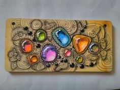 gem tangle on wood
